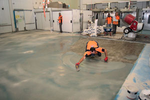 Workers from Non Slip Industrial Flooring applying non skid coating